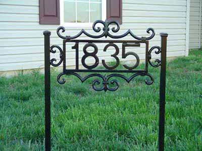 Self standing wrought iron house numbers with scroll work