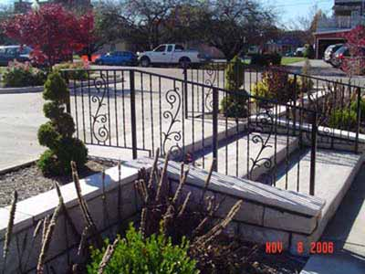 Wrought iron stair railing with internal scroll ornaments